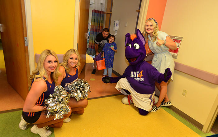 Bella visits Phoenix Children's Hospital with the Phoenix Suns and Mercury mascot