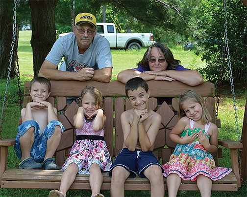 Steve Lowmaster and his grandchildren before ALS